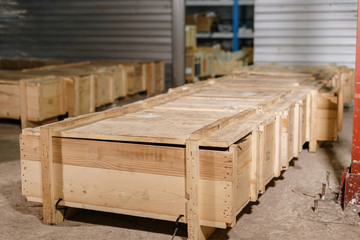 Large wooden boxes. Warehouse of spare parts for machines and mechanisms. Production of ventilation and drainpipe