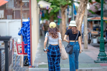 Bangkok: September 1, 2018, a group of female tourists walking along the street in Phra Nakhon district, near Tha Prachan. Cross River Ferry Pier, Thailand