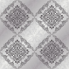Seamless background of silver color in the style of baroque. Vector seamless border in Victorian style. Damask wallpaper.