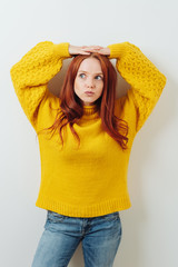 Young redhead woman with a pensive expression
