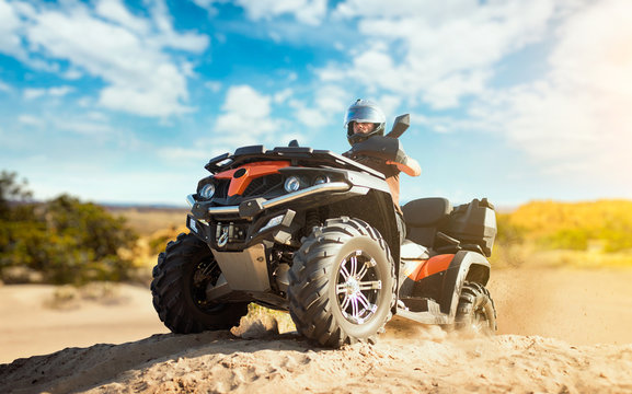 Summer offroad adventure on atv in sand quarry