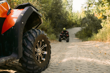 Two riders on quad bikes having offroad adventure