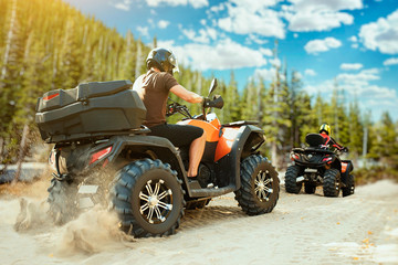Wall Murals Motor sports Two quad bike riders in helmets travels in forest