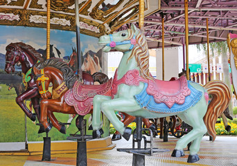 The vintage style horse carousel on the playground.