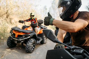 Poster Motorise ATV rider showing thumbs up to his partner