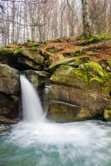 waterfall Davir on the Turichka river in the forest near Lumshory village of TransCarpathia, Ukraine. beautiful autumnal scenery