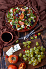 autumn salad with fruits and cheese