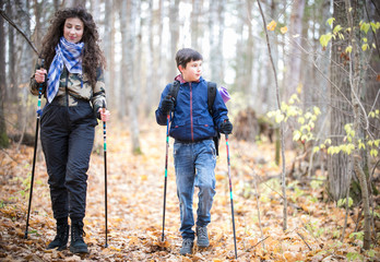 Nordic walking. Little boy and young woman
