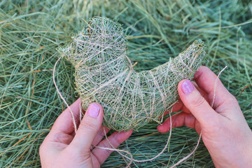 Handmade. Weaving with meadow grass