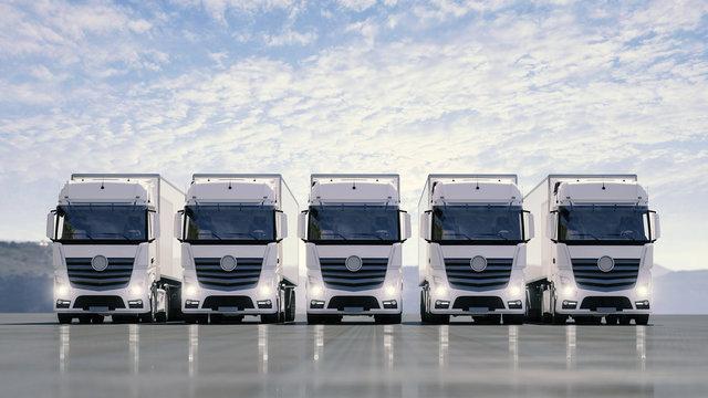 Eine Flotte von weißen LKW steht auf einer Straße
