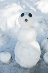Snowman standing in winter landscape.A happy looking snowman on the frozen.Winter time - snowman in nature in cold day.