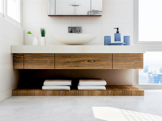 Solid wood washstand in the spacious bathroom with toiletries and green plants