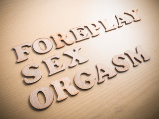 Sex Foreplay Orgasm, lifestyle health wooden words typography lettering concept