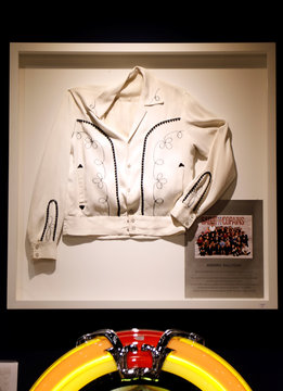 An original jacket worn on stage in 1966 by late French singer Johnny Hallyday is displayed among items related to the career and life of the singer before an auction at Drouot auction house in Paris