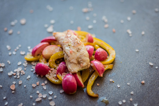 Grilled chicken with yellow bell peppers and red radishes