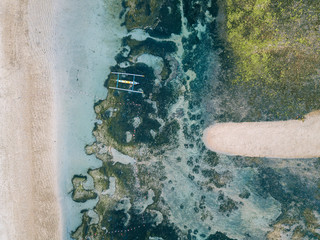 Indonesia, Bali, Aerial view of Sanur beach, traditional boat