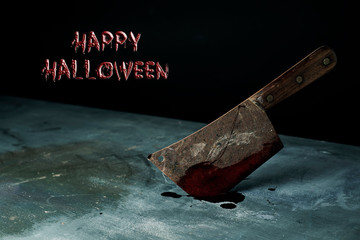 cleaver full of blood and text happy Halloween
