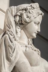 Sensual neoclassic woman marble statue in Burggarten park in Vienna, Austria, details, closeup