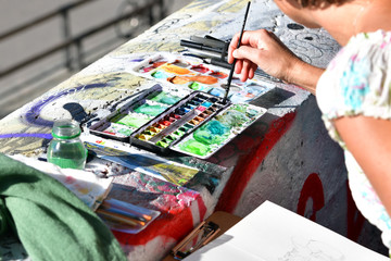 Hands Creation picture abstract of watercolor painting with brush in Art subject outside classroom  in France