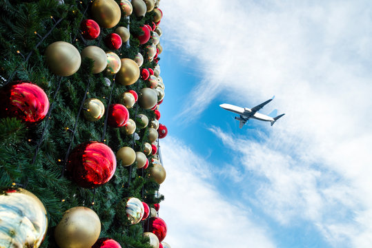 Decorated Christmas tree and airplane in  blue sky