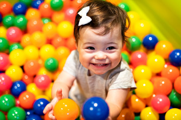Portrait of a adorable infant on colorful balls