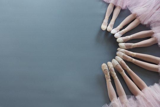 Little ballerinas legs in pointe shoes on floor