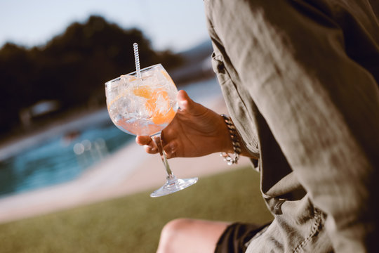 Man drinking cocktail near the pool
