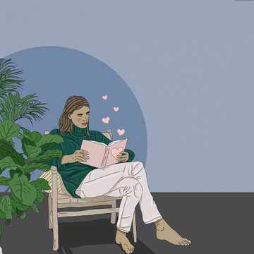 Young woman reading book while sitting on chair at home