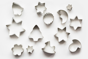 Various Christmas-themed cookie cutters.Christmas cookie cutters on white. Holiday card.
