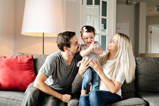 Family mother, father, child daughter at home