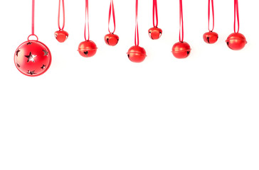 Jingle Bells with Ribbon Hanging in front of White Background