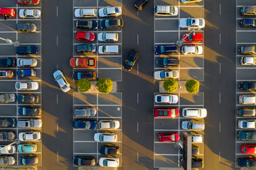 Top down view from drone on mall parking with many cars. Fototapete