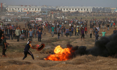 Palestinian demonstrators gather at the Israel-Gaza border fence during a protest in Gaza