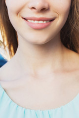Beautiful smile of young pretty girl close up portrait