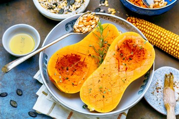 Pumpkin with different vegetables on the old wooden table top view ,Butternut