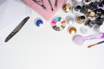 Manicure - tools for creating, gel polishes, all for the treatment of nails, the concept of beauty, care. Banner for inscription salon