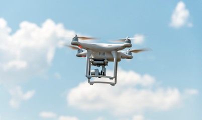Drone with digital camera flying in the sky.