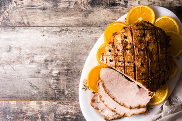 Tradicional homemade honey Glazed Ham for holidays. Top view. Copyspace