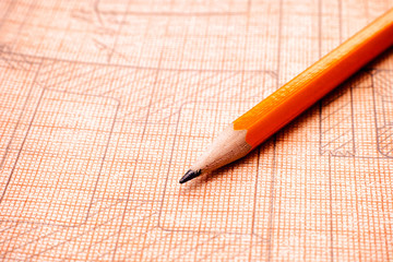 Old technical drawing on graph paper with orange pencil.