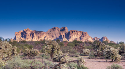 The Superstition Mountainsi is a range of mountains in Arizona located to the east of the Phoenix metropolitan area.   Clear blue sky great for dropping text onto.