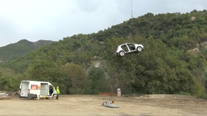 Car is lowered by a helicopter after being brought down from a village left isolated after a rockslide in April, in Sospel