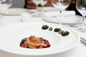 Foie gras with port sauce on table
