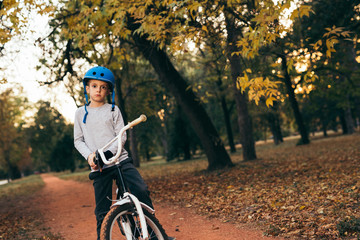 cute little boy with his bike outdoor