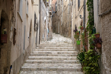 This is one of the alleys that climb to the Medieval center of Caiazzo, a lovely town in the Italian region of Campania. Few tourists have found their way to the town and you can discover it quietly.