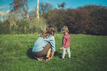 Mother and toddler relaxing in meadow
