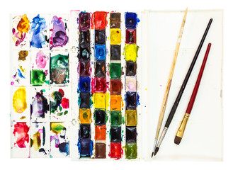 watercolor paints with pallet and few paintbrushes