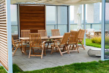 Outdoor patio with wooden chairs and table