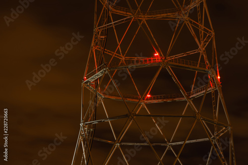 night industrial background - fragment of a lattice tower