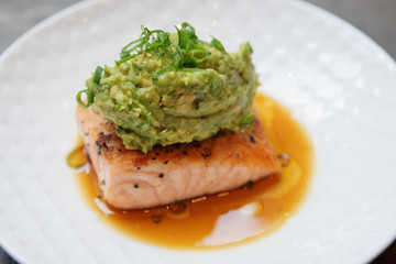 Salmon steak with avocado sauce