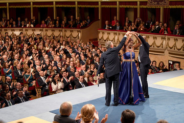 Githingji Gitahi, Nice Nailantei Leng'ete and Alvaro Rengife are applauded after receiving the 2018 Princess of Asturias award for International Cooperation from Spain's King Felipe, during a ceremony at Campoamor Theatre in Oviedo